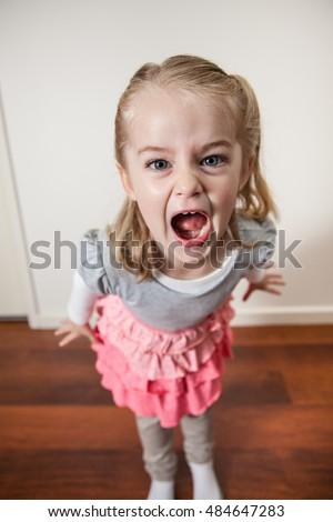 Expressive Little Girl Dress Sitting On Stock Photo