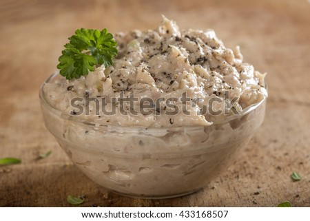 Creamy fish pate in bowl made with tuna, onion and butter