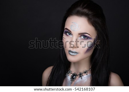 Creative make-up new conceptual idea. Purple silver bold faceart body art painting. Crazy new graphic abstract picture woman face surrealistic. professional photo. Creativity lines conceptual winter
