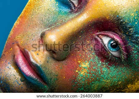 Creative make-up of colored powder closeup