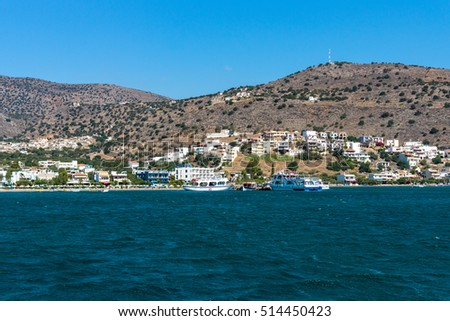 CRETE, GREECE - JULY 11, 2016: View from the sea on the north coast of Crete, on the west side of the Gulf of Elounda.