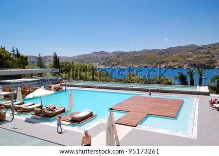CRETE ISLAND, GREECE - MAY 17: The tourists enjoying their vacation at luxury hotel on May 17, 2010 in Crete, Greece. 15000000 tourists have visited Greece in year 2010