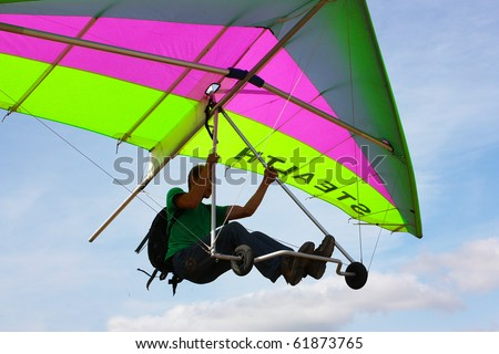 CRIMEA, UKRAINE - SEPTEMBER 9: Competitor of the Grininko hang gliding competitions taking part on the Klementieva  mountain on September 9, 2010 in Crimea, Ukraine