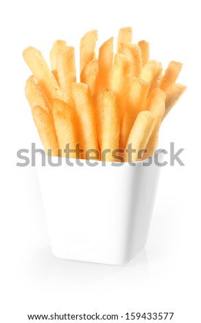 Crisp deep-fried golden potato chips, or French fries, standing upright in a plain white ceramic container over a white background