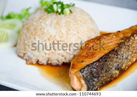 crispy grilled salmon steak with rice.