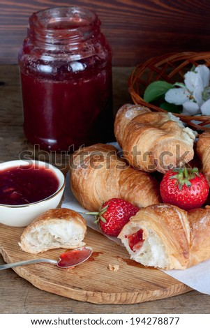 croissants and a glass of strawberry jam