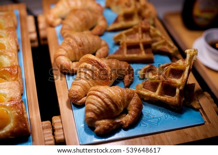 Croissants and waffle pastry in buffet