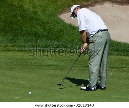 CROMWELL, CT - JUNE 28: Final Round of the Travelers Championship Golfer Bob Heintz sinks his putt on the 18th green at TPC River Highlands Golf Course on June 28, 2009 in Cromwell, CT.