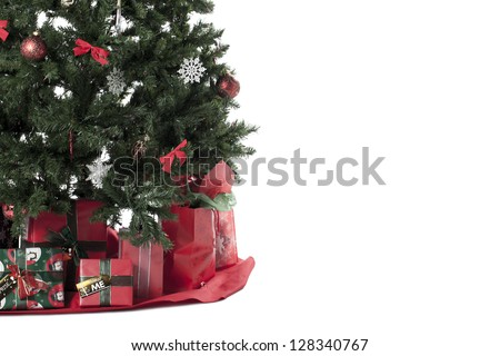 Cropped image of Christmas tree surrounded by gifts