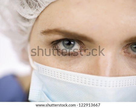 Cropped image of nurse face against white background