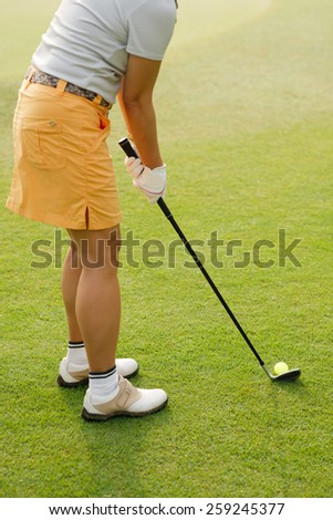 Cropped image of woman playing golf