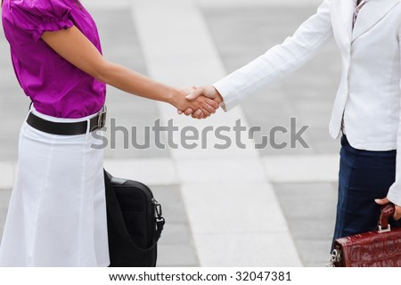 cropped view of two business women shaking hands. Copy space
