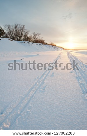 Cross country skiing at sunset, seaside