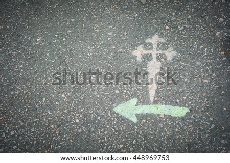 Cross of Santiago painted on asphalt