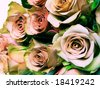 cross process  technique photographic reproduction showing a detail of an wedding bouquet with beautiful brownish roses - stock photo