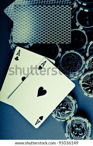cross processed poker setup displaying aces on chips and cards