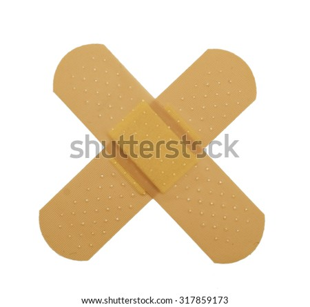 crossed bandaid isolated on white