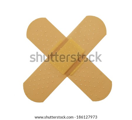 Crossed bandaid isolated over white