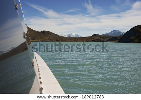Crossing lake in patagonia by a boat