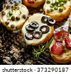 Crostini with different toppings. Delicious appetizer - stock photo