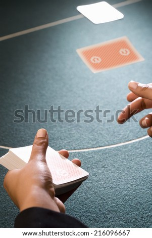 Croupier dealing cards, close-up of hands