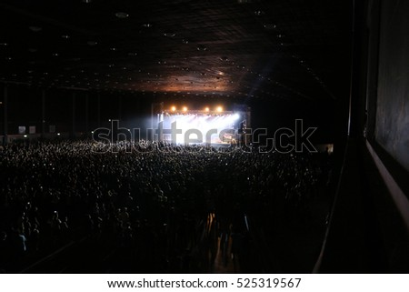 Crowd at concert and blurred image