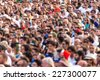 Crowd of football fans watching the match in the streets. Out of focus. - stock photo