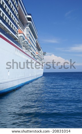 Cruise ship on a bright sunny day at sea.