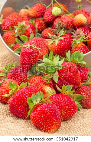 Crumbled large ripe strawberry on sacking