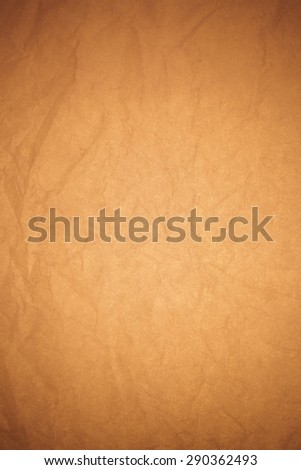 Crumpled brown paper background.