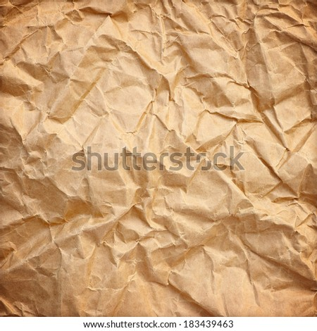 Crumpled paper background vignette