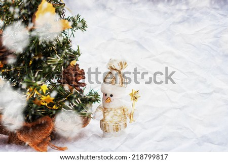 crumpled paper texture. snowmen in the winter woods near a Christmas tree