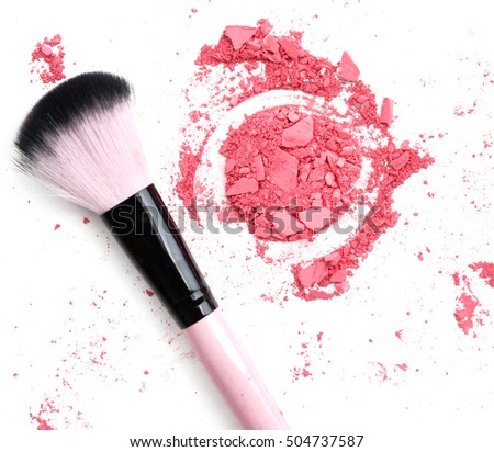 Crushed pink powder make up with brush isolated on white
