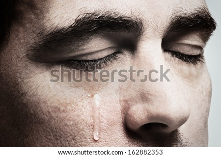 stock-photo-crying-man-with-tears-on-fac