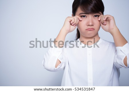 Crying woman on isolated background