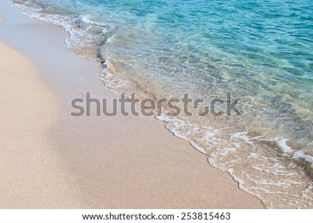 Crystal clear wave washing over sandy Black sea shore
