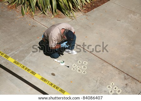 CSI Crime Scene with Chalk Outlines and Sheriff do not cross caution tape. shot outside in direct daylight with shadows.