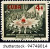 CUBA - CIRCA 1957: A stamp printed in Cuba shows image of scouts around a campfire, celebrating the centenary of scouting, circa 1957 - stock photo