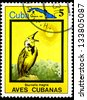 "CUBA - CIRCA 1983: A stamp printed in Cuba shows Sturnella magna, with the same inscription, from the series ""Cuban Birds"", circa 1983 - stock photo"