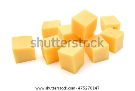 Cubes of cheddar cheese isolated on white