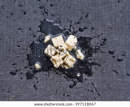 cubes of fine feta cheese on a black board