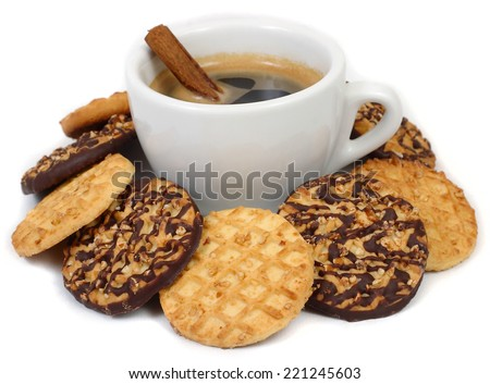 Cup of coffee and chocolate cookies on a white background.