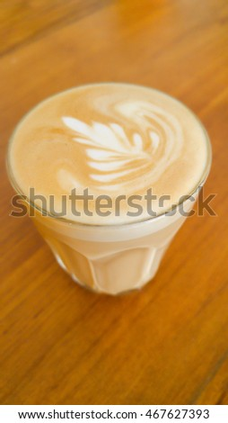 Cup of coffee latte in coffee shop