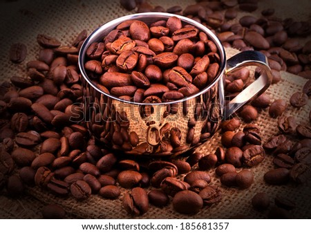 cup of Coffee  with coffee bean. Vintage background
