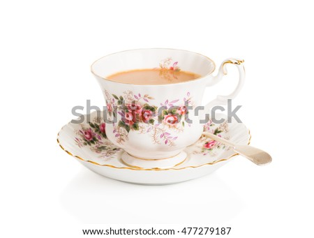 Cup of English breakfast tea in vintage teacup and saucer with antique spoon on a white background