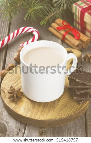 Cup of hot cocoa on a dark background. Toning