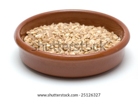 Cup of wheat, isolated on white