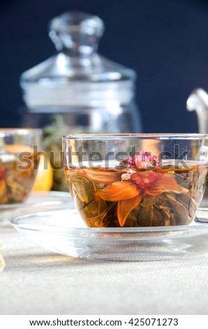 cup oolong tea glass with fruit and glass kettle