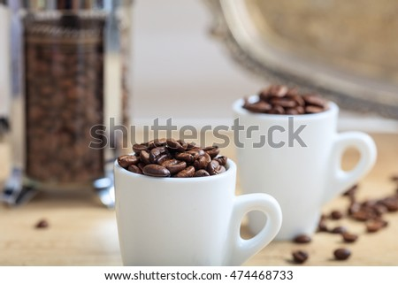 Cups full of coffee beans
