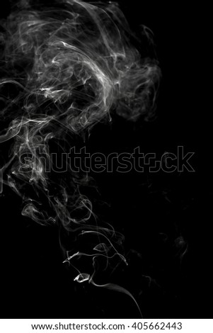 curls of white smoke on a black background